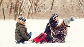 Lovely Kids And Mother Having Fun Together In Snow At Park. Winter Outdoors Game. Winter Holidays, V poster