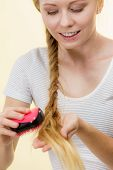 Blonde Girl With Long Braid Hair Holds Brush poster