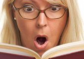 Surprised Woman Reading A Book
