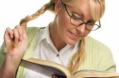 Female Plays With Ponytail & Reads Her Book