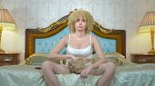 Blonde Girl With Plastic Wrap To Lose Weight On Her Hips And Stomach, Sitting On The Bed And French  poster