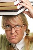 Disgruntled Woman With Stack Of Books