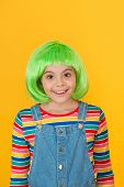 Wig Haircut That Is Easy To Manage. Happy Girl Wear Green Hair Wig Yellow Background. Little Girl Sm poster