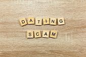 The Words Dating Scam On A Wooden Background poster