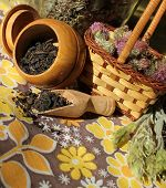 Dry thistle in a basket, black tea and green tea