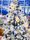 White Decorated Christmas Tree. White Decorated Christmas Trees With Many Gifts In Delicate Pastel C poster