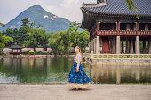Young Caucasian Female Tourist In Hanbok National Korean Dress At Korean Palace. Travel To Korea Con poster