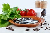 Anchovy Fish On A Plate With Herbs, Branch Of Tomatoes And Spicy poster