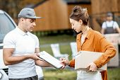 Couriers Delivering Goods To A Young Woman Home By Cargo Van Vehicle, Client Signing Documents, Move poster