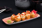 Close Up Of Assorted Baked Sushi Set With Salmon, Shrimp, Caviar, Mussels, Tuna, Cream Cheese And Ho poster