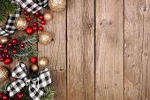 Christmas Side Border With White And Black Checked Buffalo Plaid Ribbon, Decorations And Tree Branch poster