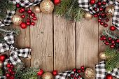 Christmas Frame With White And Black Checked Buffalo Plaid Ribbon, Baubles And Tree Branches. Top Vi poster