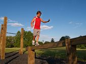 Young Boy On A Balance Beam