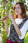 picture of shepherdess  - Pretty medieval woman standing near the birch - JPG