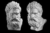 Two Bust Of Hercules. Heracles Head Sculpture, Plaster Copy Of A Statue Isolated On Black. Son Of Ze poster