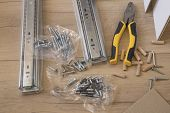 Furniture Assembly Parts And Tools For Self Assembly Furniture, On The Floor. poster