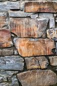 Stone Wall. Close-up Wall Of Hewn Wild Stone. Stone Background. Stone Texture For Creativity. poster