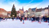 Ice Skating rink near the Cathedral in Strasbourg, France, Christmas Time poster