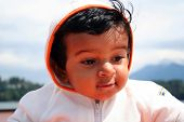 image of peeping-tom  - closeup of a cute little toddler - JPG