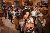 Sexy Woman Points Gun In Saloon