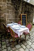 Dining Table In Front Of The French Medieval Buildings