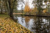 Channel And Jetty Along Channel In Autumn Mood poster