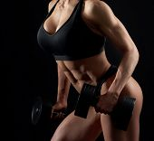Attractive, Sexy, Female, Muscular Body In Black Sportswear On Black Background. Young, Strong Woman poster