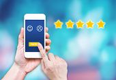Hand Click Rating On Mobile To Give Satisfaction Of Service Online.customer Review Experience Of Ser poster