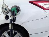 White Car Fuel Filler At Fuel Station. Fuel Dispenser At Gas Station. poster