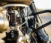Motorcycle Engine And A Motorcycle Fuel Tank Close-up poster
