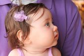 Baby with Purple Hair Bow