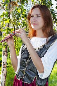 stock photo of shepherdess  - Pretty medieval woman standing near the birch - JPG