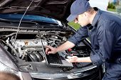 image of combustion  - Professional car mechanic working in auto repair service - JPG