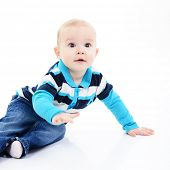 full legth portrait of cute happy smiling little boy toddler sitting in studio, 11 month, studio over white