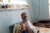 stock photo of oxygen mask  - Patient with oxygen mask in a hospital ward - JPG
