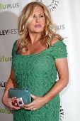 BEVERLY HILLS - MARCH 14: Jennifer Coolidge arrives at the 2013 Paleyfest