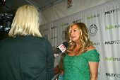 BEVERLY HILLS - MARCH 14: Jennifer Coolidge is interviewed by the media at the 2013 Paleyfest
