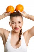 Beautiful girl with two juicy oranges