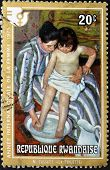 RWANDA - CIRCA 1975: A stamp printed in Rwanda shows the work the bath by Mary Cassatt, circa 1975