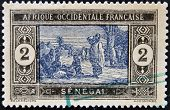 stamp printed by Senegal shows Senegalese Preparing Food circa 1914