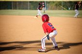 stock photo of little-league  - Little league baseball player looking to steal second base - JPG