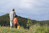 Grandfather and Grandson Going Fishing