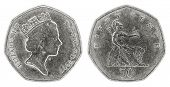 picture of copper coins  - A well worn fifty pence coin with Queen Elizabeth II on a white background - JPG