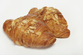 stock photo of doughy  - two times croissant with almond splinter close up - JPG