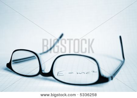 poster of Glasses And Paper With E=mc2