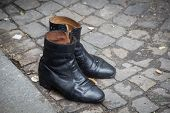 pic of cobblestone  - Empty shoes on the cobblestone street in Paris France - JPG