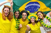 stock photo of enthusiastic  - Group of happy brazilian soccer fans commemorating victory - JPG