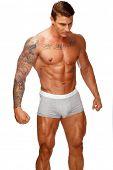 Man with beautiful muscular tattooed torso in underwear