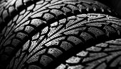 winter car tyre on a black background