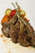 Постер, плакат: Grilled lamb loin potato dranik and vegetable ratatouille